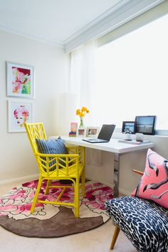 Pop of color home office beach style with bright yellow desk chair natural light
