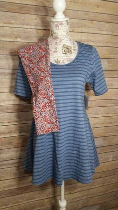 XS Perfect Tee with One Size leggings! Find this outfit at LuLaRoe Sweethearts! Outfit inspiration! Boutique Clothing. Blue on Blue Stripes with Red and Blue Patterned leggings! Pattern mixing!