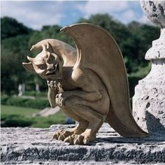 Gargoyle -- I have one of these in my garden! It's made of some plastic polymer.