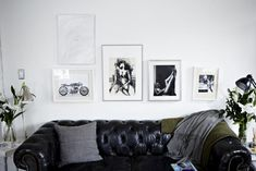 Kristin Barone, Living Room, black chesterfield sofa, black and white images in white frames, Remodelista