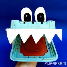 Never smile at a crocodile!!! Unless it's made from a berry box and a bit of egg carton...then it's fine.