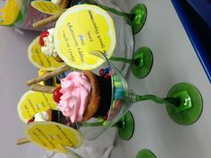 Cupcake in a martini glass fun gift or table centerpiece... I put skittles but you can use m or peanuts etc. then I placed a pirouette wafer and placed the cupcake on top... I made lemon note tags to add that special touch...