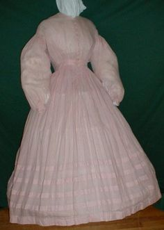 Pink sheer cotton dress. High bodice gathered into a band, functioning buttons; bishop sleeves; gathered skirt with four tucks. Graceful Lady.