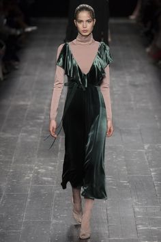 Valentino features a ballerina inspired turtleneck with a green velvet dress on…