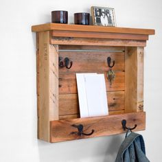 Use this piece to organize your entryway by storing your keys, phone, hats, mail and many other items.This wooden mail organizer has been built from reclaimed pallet wood and is a great way to add rustic charm and organization to your home!  This piece has 2 black double hooks and 2 black single hooks. The two top hooks could be used to hang your keys and the bottom double hooks could be used to hang your hats, scarves and other items.