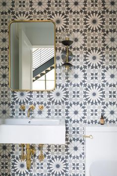 Ann Sacks Eastern Promise Field Tiles generously decorate bathroom walls with gray floral mosaic hues.