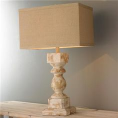 Distressed Baluster Table Lamp Add an architectural detail with this distressed wood cream painted baluster table lamp and rectangular burlap shade. Farmhouse Table Lamps, Table Lamp Wood, Farmhouse Decor, Bedside Desk Lamps, Traditional Table Lamps, Diy Home Decor Rustic, Unique Table Lamps, Floor Lamp Base, Table Lamp Shades