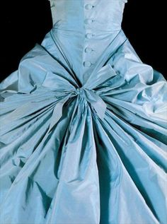 Balenciaga 1953. Blue and oh the gathering, the buttons, the fold.  Swoon and swoon again.