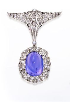 An art deco color-change sapphire and diamond brooch, circa 1925