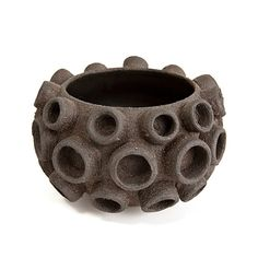 What I like about this is how the circular shapes are 3D.. and the different sizes of the circles at different parts of the pot