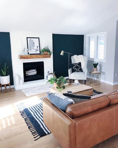 Navy blue accent, white fireplace, light wood floors, grey walls in the rest of the room! Navy Living Rooms, Accent Walls In Living Room, Living Room White, Living Room Grey, Home Living Room, Living Room Designs, Living Room Wall Lighting, Blue And Brown Living Room, Navy Blue Rooms