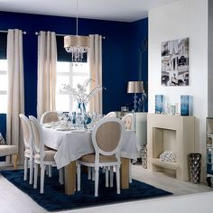 Elegant blue and white dining room Create a dramatic look with deep indigo walls, French-style furniture, super-glam glass and high-shine finishes. A blue palette is perfect for giving your dining room a sultry look - but use in moderation to avoid overwhelming the scheme.