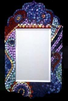 Ooh, love how the mosaic frame gives this ordinary rectangular mirror some shape!