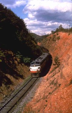 A rare photo of a westbound hopper train lead by two WM F7's in the deep cut at Little Orleans