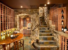 Traditional Home Tuscan Design,   Wow..what a wine cellar! Love the color of the step. by KGA Studio Architects via houzz.com
