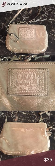 🎉FINAL MARKDOWN🎉Coach Wristlet Beautiful cream glittered Coach Poppy Wristlet with silver toned hardware and a pastel purple interior. In GUC. Very slight mark on front as pictured. Coach Bags Clutches & Wristlets