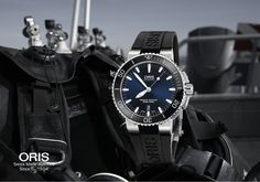 Deep Blue The Oris Aquis is a fully functional watch that does not compromise on style, and is as at home in the urban jungle as it is deep beneath the waves. Ref: #Oris #Aquis Date, 733 7653 4135