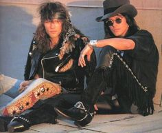 Jon Bon Jovi and Richie Sambora looking cool in 80's chic fashion - leather, fringe, cowboy boots, and tight, decorated jeans cut at the knee ☺