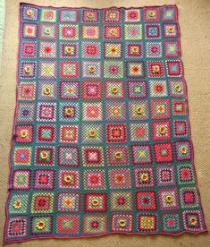 Inspiration - Love how this has the random 3-dimentional flower squares. It brings so much more interest to the old fashioned granny square blanket.