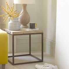 POSTINO SIDE TABLE This is our own favourite side table. With its reclaimed pine boards and vintage-looking metal legs, this is a versatile number as it works equally well in smart or elegantly shabby surroundings.