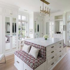 Luxury Master Wardrobe with island dresser, built-in seating, and lots more...
