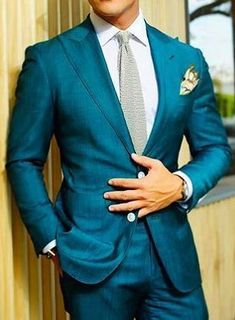 How beautiful is this teal blue tailored suit over white shirt? Come into our private showroom and have your very own suit custom made from our design team at Giorgenti New York! Teal Suit, Burgundy Suit, Blue Suit Wedding, Wedding Suits, Wedding Groom, Tuxedo Wedding, Table Wedding, Mens Fashion Suits, Mens Suits