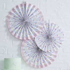 Fabulous whtie fan decoration with colourful sprinkles design. Perfect for decorating party and wedding venues!Cute Hanging fan decorations, perfect for any party, wedding or baby celebration! The colourful sprinkle design is great for decorating your celebration. Each pack consists of three fans, 2 x 36cm D and 1 x 28cm D. Paper clips are included in the pack to secure fans in place and can be packed away to use again. Other fun party products are avaliable in our Pick and Mix range…