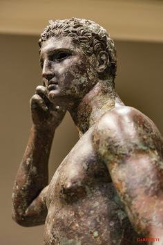 """The Victorious Youth""-A BRONZE Greek statue's survival is a rarity! However, this statue, like the Riace statues, survived a Roman shipwreck in the Adriatic Sea, only to be discovered 2,000 years later by divers or fishermen. Romans once took these statues for a variety of purposes such as to be admired, or to be melted down and re-used for building materials. We are fortunate that a few survived."