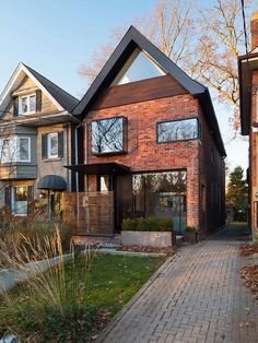 Pitched roof gives the home a classic and distinct facade Early 1900s Toronto Home Charms with a Glassy Modern Renovation