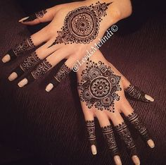 A beautiful mandala and fingertips design by Leeds Mehndi.