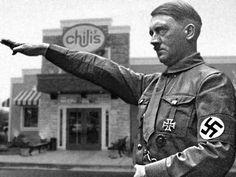 Adolf Hitler giving his salute.