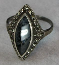 no this one: http://www.etsy.com/listing/48606202/faux-1800s-onyx-ring-from-john-waynes?ref=sr_gallery_10&ga_search_submit=&ga_search_query=onyx+ring&ga_view_type=gallery&ga_ship_to=US&ga_page=2&ga_search_type=vintage&ga_facet=vintage