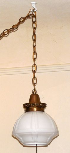 ednasvintagecloset-etsy Hanging Swag Light Fixture  Up for sale we have this awesome hanging swag light fixture  This great piece is made of brass with an ornate Art