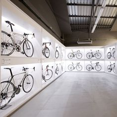 Bicycles are displayed in backlit boxes at this Barcelona bike store designed by architect Joan Sandoval.