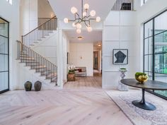 Love the color/design of the wood flooring. Want this overall look with white walls and wood floors throughout. Like the foyer and staircase design. Foyer Design, Staircase Design, Foyer Staircase, Dream Home Design, My Dream Home, Decor Interior Design, Interior Decorating, Hallway Decorating, Home Decor Inspiration