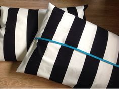 Ikea Fabric... I literally have these DIY pillows in my living room!