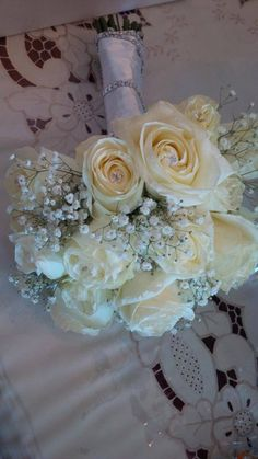 White roses and baby's breath bridal bouquet by Royal room weddings