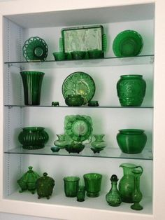 Connie Dickens has been collecting emerald green glass for 40 years.  Doesn't it look so refreshing and calm against a white background?   Connie says that the pieces range in age.   And, yes, there's a large green marble on the vase on the lower shelf.