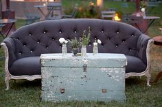 Couches, chairs and end tables set out for the reception gives a homey, rustic, vintage feel. LOVE IT!