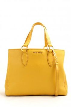 shopping miu miu vitello caribù mimosa. Yellow leather bag, three compartments, central compartment with zipper, side compartments with inside a zipped pocket + opened pocket + two opened pockets. Two handles and a removable shoulder strap. Cotton pink satin lining. Miu Miu Spring Summer Collection 2013.    Height: 26 cm. Width: 35 cm. Depth: 15 cm. Handle height approx.: 15 cm. Shoulder strap length: 100 cm.