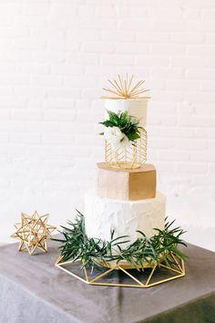 gold and greenery geometric industrial wedding cake