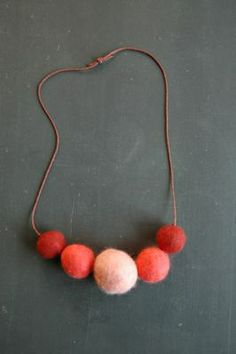 Felt ball necklace - would be great to make with kids this christmas. Would even work on clips and headbands