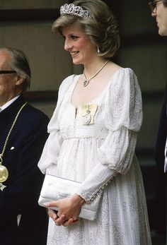 Princess Diana attended an event at the Royal Academy in a lovely white maternity dress, accessorized with the Spencer Family Tiara and a diamond necklace.        Credit: Tim Graham/Getty Images                    Princess Diana attended an event at the Royal Academy in a lovely white maternity dress, accessorized with the Spencer Family Tiara and a diamond necklace.        Credit: Tim Graham/Getty Images - via StyleList