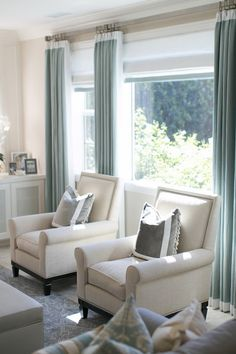 Wonderful colours - soothing off-white and creams with duck-egg of tiffany blue touches. Stylish armchairs and curtains.