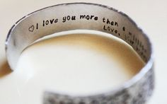 you can custom order one of these cuffs and write any message you want on the inside.. cutest gift ever