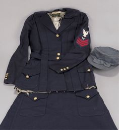 U.S. WWI Navy Yeoman (F) uniform, women's uniform. The hat is that of a WWII American Red Cross uniform but the rest of the uniform is for a WWI Yeomanette