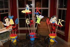 Snow White birthday party centerpieces.