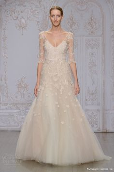 Monique Lhuillier Fall 2015 | Natalia three quarter illusion sleeve A-line wedding dress with V-neck.