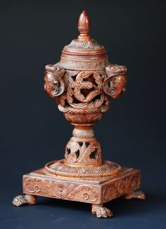 A late 18thc/early 19thc finely carved coquilla nut inkwell, possibly French. There is no evidence that this has ever been used for ink as there is no staining to the ink liner.  The lid has an acorn finial leading down to a foliage design with a rope twist decoration.