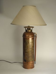 Fire extinguisher lamp. Time to restyle mine to this height. Badger family history.